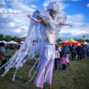 Iridescent dream fairy stilts costume by Hala the stiltwalker Toronto buskerfest 2017