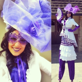 Stiltwalker Madame Mauve purple and white stilts costume Hala Toronto circus performer échasses