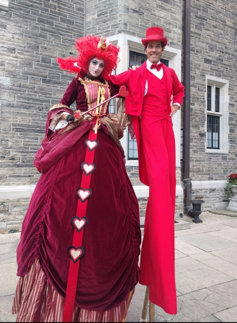 Red queen of hearts stiltwalker Hala on stilts Toronto entertainment Casa Loma 2017