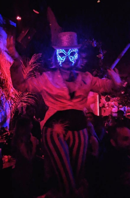 Hala on stilts ELwire mask pink circus stilt walker Wildflower Toronto 2017
