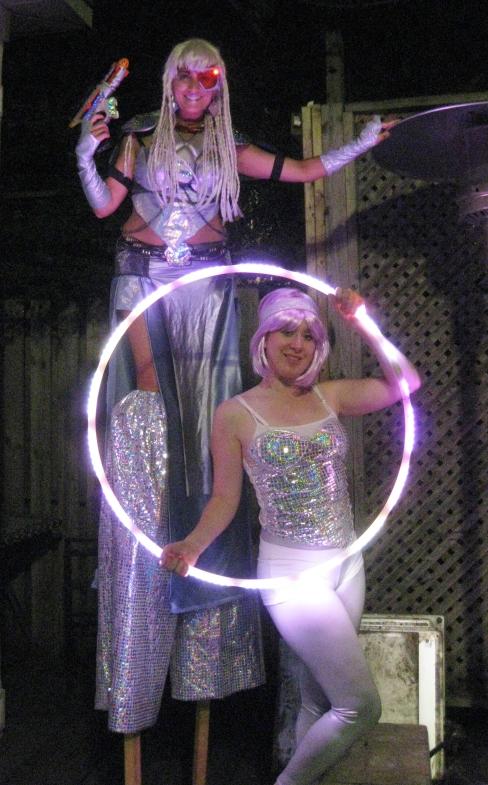 Sparkly cyborg Hala on stilts stiltwalker and Bex in Motion Hamilton