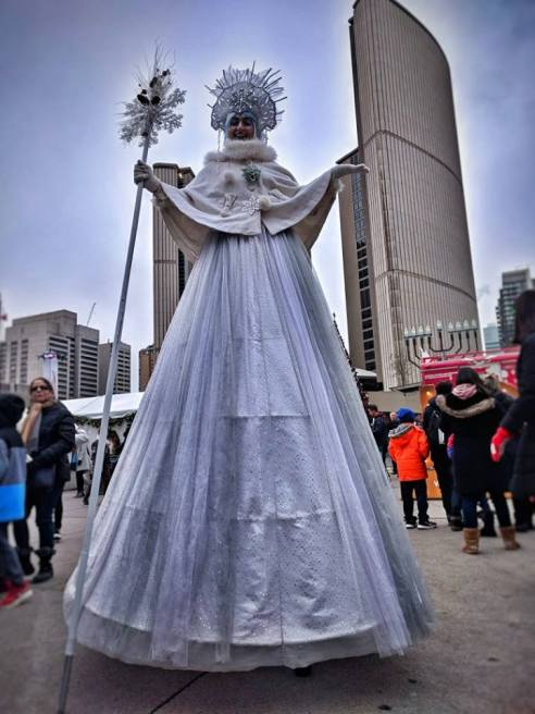 Toronto City Hall stiltwalker holiday fair in the square 2017 Hala on Stilts Entertainment