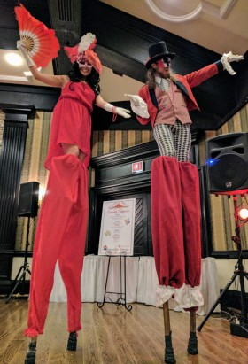Hala on stilts red and white costumes Old mill stiltwalkers stilting entertainment Toronto