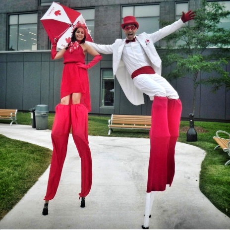 stiltwalkers Toronto Canada 150 red and white costumes Hala on Stilts échasses