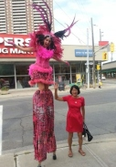 pink flamingo carnival stilts with Olivia Chow