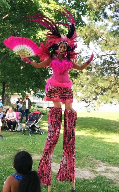pink flamingo carnival stiltwalker Toronto