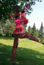 Hala on stilts Toronto Carnival feathers