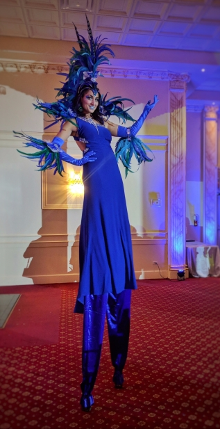 carnival feathers stiltwalker blue caribana costume Hala on Stilts Entertainment Toronto