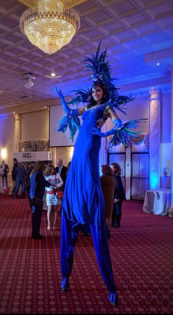 Carnival Stilt walker Blue feathers samba soca caribana mardi gras Hala on stilts Toronto entertainment 2017