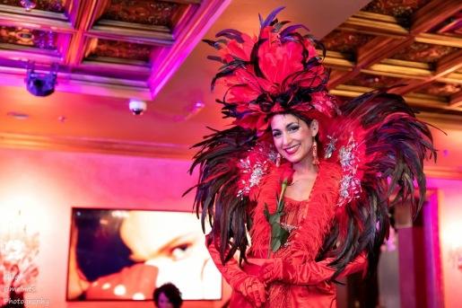 Hala on stilts red carnival feathers and rose stiltwalker Toronto