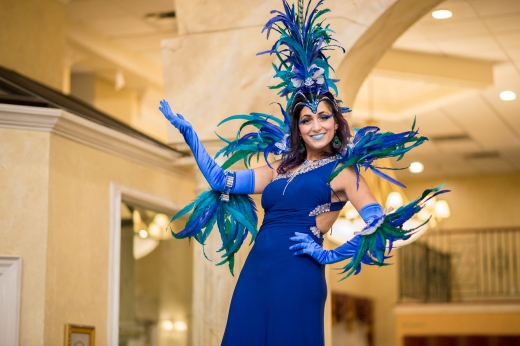 Hala on stilts blue carnival feathers costume stiltwalker Toronto Photo by Summerhill weddings