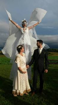 white wedding wings on stilts Hala stiltwalker Toronto best stiltwalker