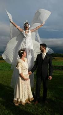 white wedding wings on stilts Hala stiltwalker Toronto best stiltwalker