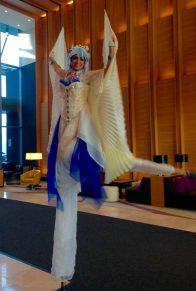 Hala on stilts blue and white wings stiltwalker Toronto