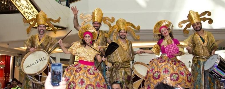 MaracaTALL stilt drummers Dubai cropped mall of the Emerates