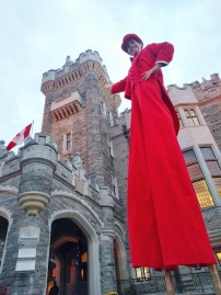 Red tuxedo costume stiltwalker Casa Loma Toronto entertainment on stilts