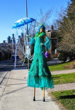 Book Hala on stilts hire stiltwalker stilt walker Toronto GTA April showers green garden costume