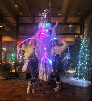 Hala on Stilts and the Spinstarlets at he Winter festival of lights Niagara 2017 LED stiltwalker costumes LED hoops