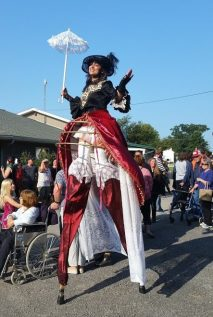 Hala on stilts lady Steampunk costume stiltwalker