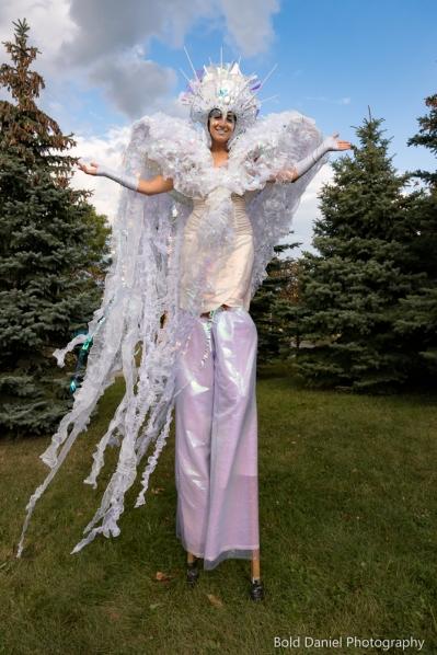 Stilt-walker Hala on Stilts Iridescent Dream Fairy Toronto Buskerfest 2017 trees