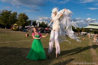 Stilt-walker Hala on Stilts Iridescent Dream Fairy Toronto Buskerfest 2017 with Bella Magic show