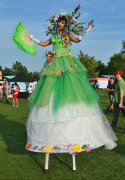 Hala on stilts May flowers Enchanted Garden Buskerfest Toronto 2018