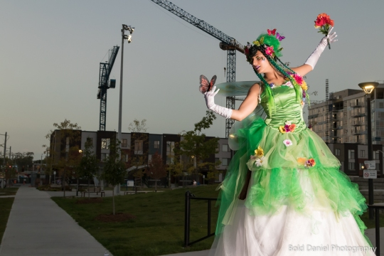 Hala on Stilts May flowers garden stiltwalker costume Toronto Entertainment cranes