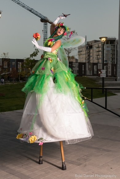 Hala on Stilts May flowers garden stiltwalker costume Toronto Entertainment elegant arch