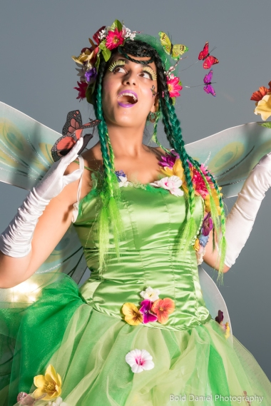 Hala on Stilts May flowers garden stiltwalker costume Toronto Entertainment cover face