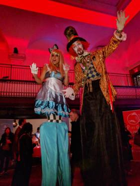 Alice in wonderland stilt-walkers Mad hatter costume stilts the great hall Toronto circus Yelp Gets Lit 2017