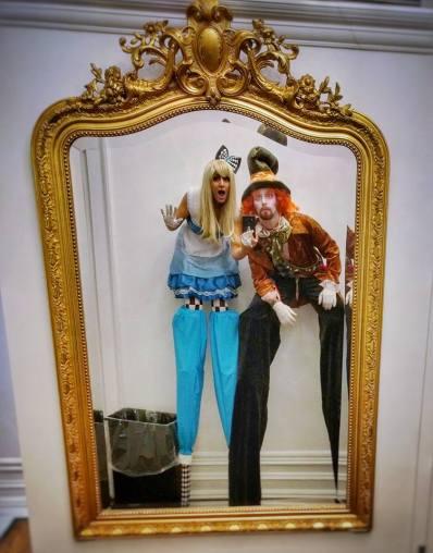 Alice through the looking glass stilt-walkers Mad hatter stilts costume Wonderland stiltwalkers Toronto circus 2017