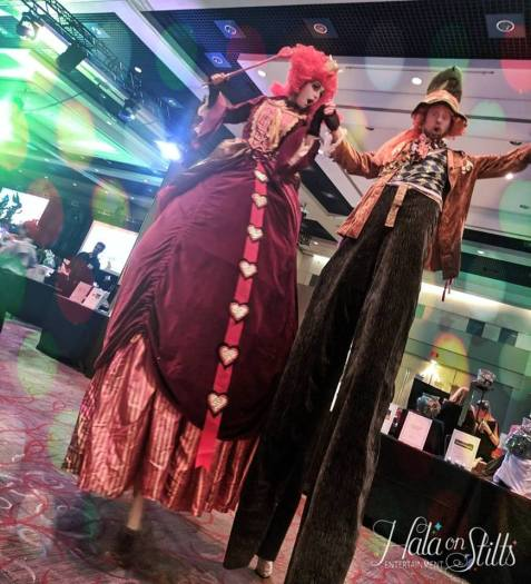 Stiltwalkers Red Queen of Hearts and the Mad hatter on stilts 2019 Toronto entertainment