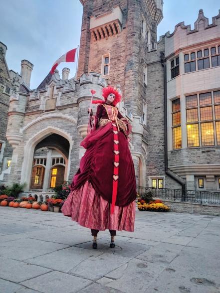 Red queen of hearts stiltwalker Hala on Stilts entertainment Toronto Casa Loma 2017