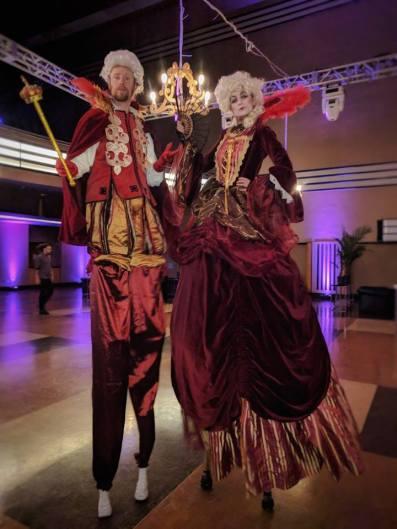 Hala on stilts circus entertainment Toronto Baroque royal couple red velvet costumes the Carlu 2017