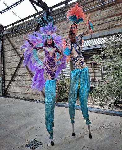 Feather carnival costumes on stilts Toronto stiltwalkers