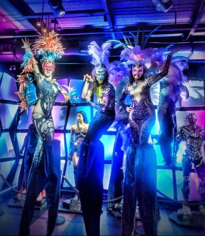 Stiltwalkers Mardis Gras Toronto Carnival feathers