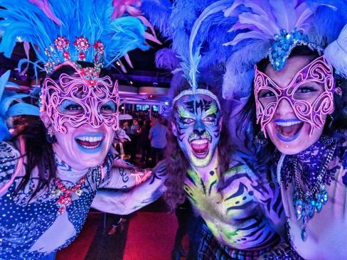Mardis Gras costumes stiltwalkers