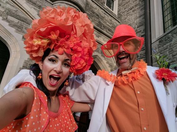 stiltwalkers in orange Casa Loma entertainment