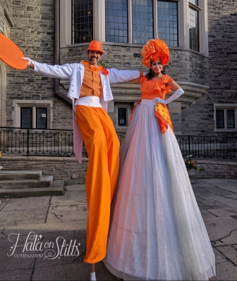 Hala on stilts orange costumes Stiltwalkers Casa loma