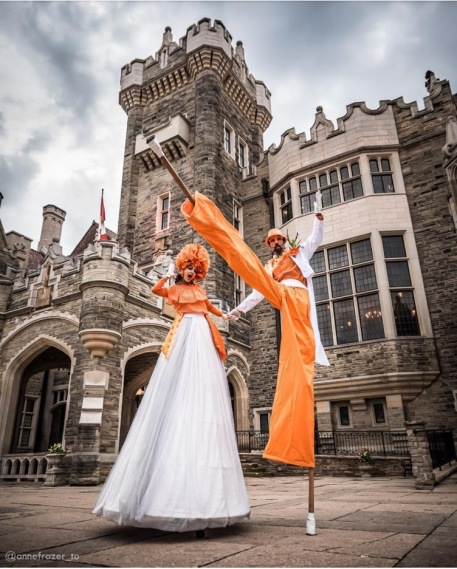 Orange stilt-walkers Casa loma 2019 Hala on Sttilts