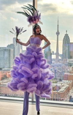 Lavender Lady stiltwalker Hala on Stilts Entertainment Toronto