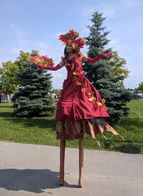 Autumn stilt walker Hala on Stilts Buskerfest 2018