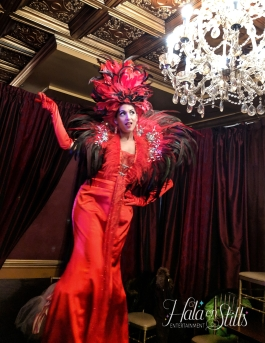 Hala on stilts red Carnival feathers stiltwalker Toronto 2019
